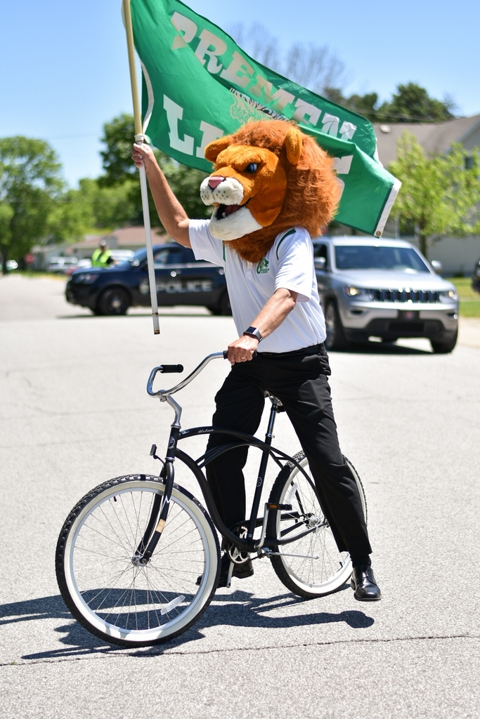 lion riding a bicycle