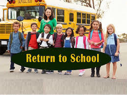 "children in  a line in front of a school bus.  Words ""Return to School"""