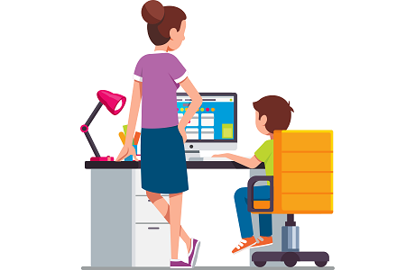 Parent standing by a desk with a child seated working on a computer